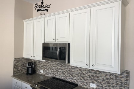 Cabinets white above stove